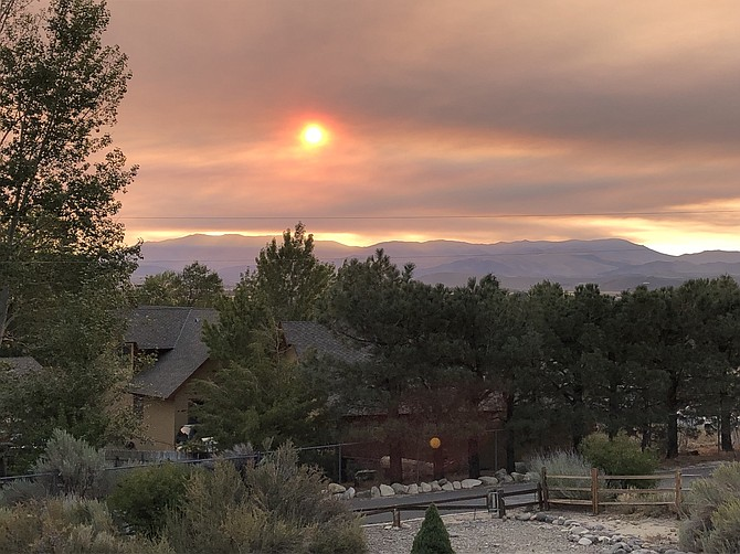 Smoke tinted the sunrise on Tuesday morning in this photo by Foothill resident Margaret Pross. Most of the smoke today is expected to come from the Caldor Fire.