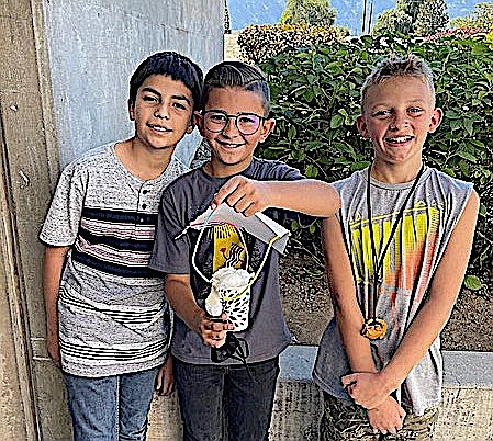 Meneley Elementary School egg drop challenge winners Edwin, Octavian, and Conway. Photo by Alicia Hill