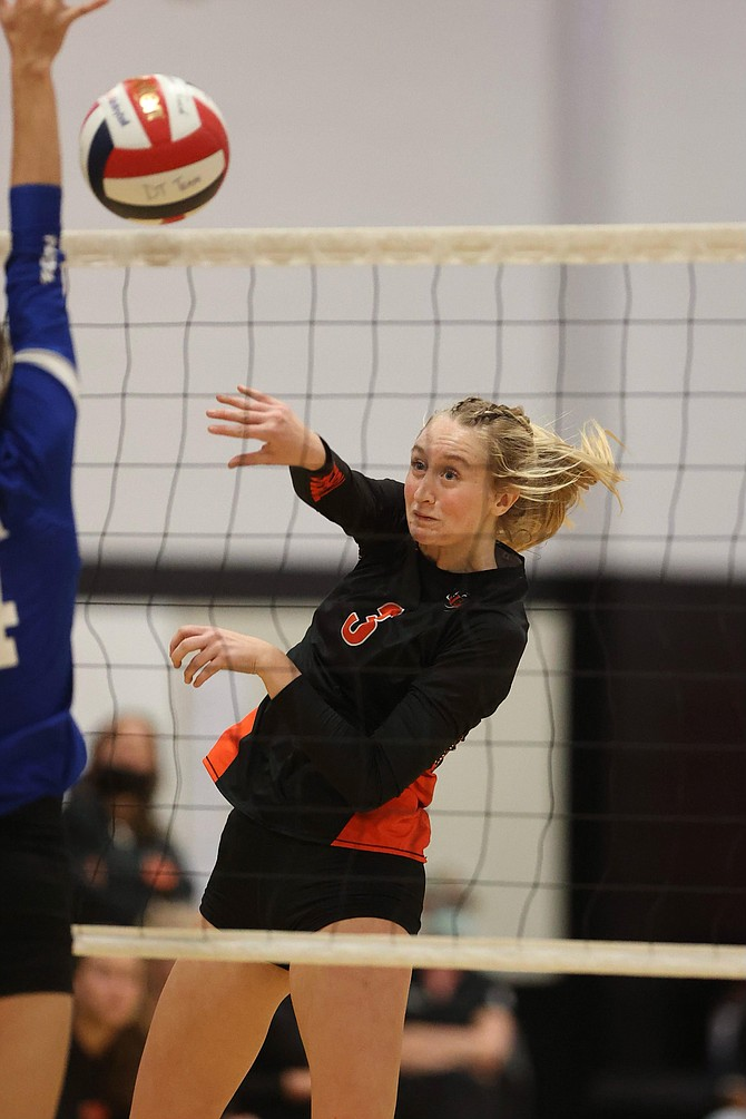 Emerson Dufloth (3) deposits one of her six kills in a four-set win over Carson Thursday night.