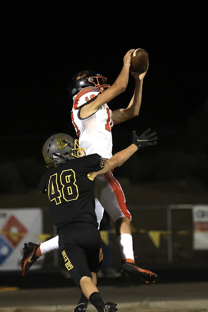 Douglas High wideout Aden Flory rises up to make a catch against Galena last Friday. The Tigers are looking for their second win in a row this season against Reed.