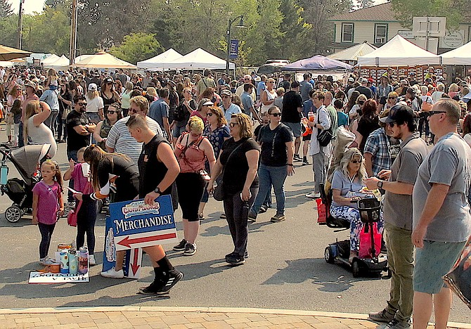 Visitors packed Genoa around lunchtime on Saturday for the annual Candy Dance. The craft faire continues 9 a.m. to 5 p.m. today.