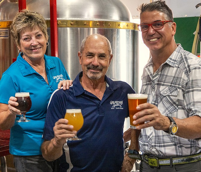 Great Basin Brewing Company founders Tom and Bonda Young raise a glass with restaurateur Mark Estee, right, CEO of Reno-based Local Food Group.