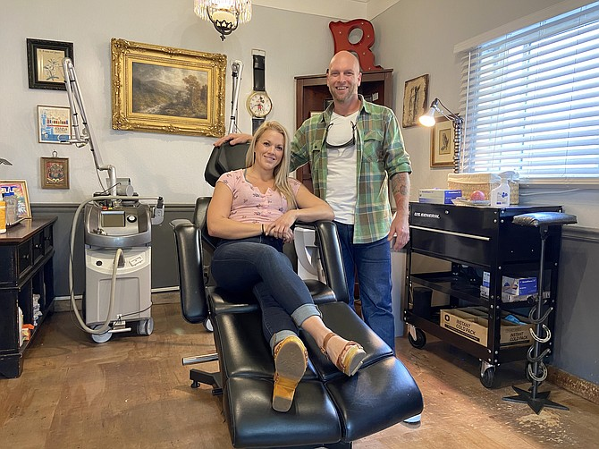 Reno Tattoo Removal owners Ron and Melanie Gregory inside their shop in Midtown Reno. The husband and wife duo say they have been busier than ever throughout the pandemic.