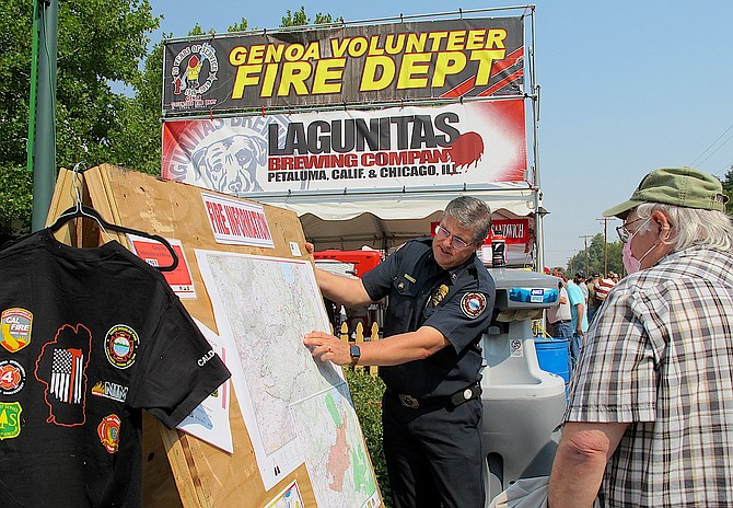 The fire information booth was located next to the Genoa Volunteer Fire Department where they were selling beer and Italian sausage sandwiches, which was guaranteed to draw an audience.