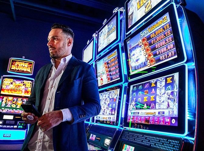Scientific Games Executive Vice President Matt Wilson discusses the company's latest cashless gaming products at the company's Las Vegas showroom on Friday, Sept. 10, 2021.