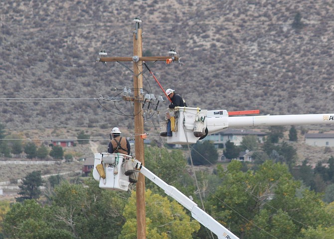 An NV Energy line crew works to restore power on Tuesday morning after a public safety outage.