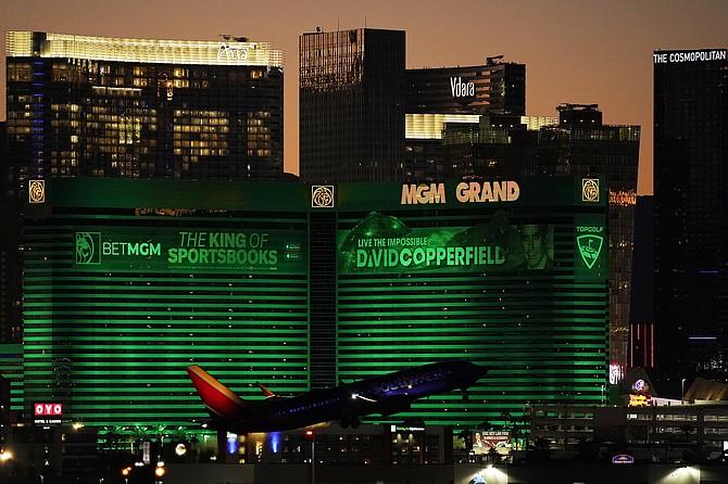 A plane takes off from McCarran International Airport near casinos along the Las Vegas Strip on Sept. 29, 2021, in Las Vegas. (AP Photo/John Locher)