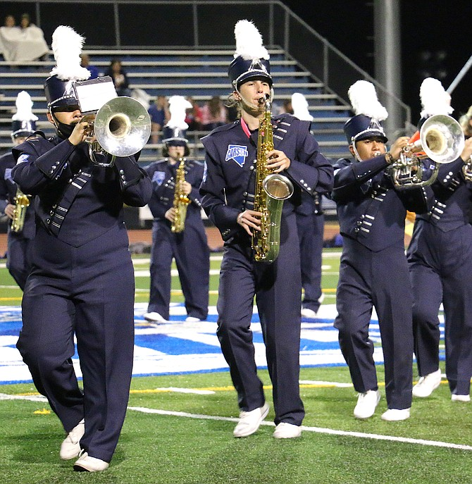 Carson High School Blue Thunder members Pablo Salgado, left, Brett Barbarigos and Alexis Garcia Perez perform at the school's homecoming game on Sept. 24 against McQueen High School. The band is preselling tickets for its Chili Bingo Night fundraiser on Oct. 15. (Photo: Jessica Garcia/Nevada Appeal)