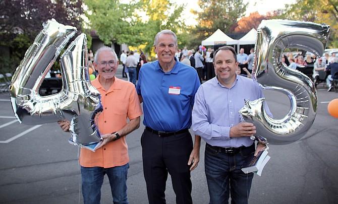 Albright & Associates partners Eric Kronawetter, Deane Albright and Travis Clark at the Sept. 24 celebration.