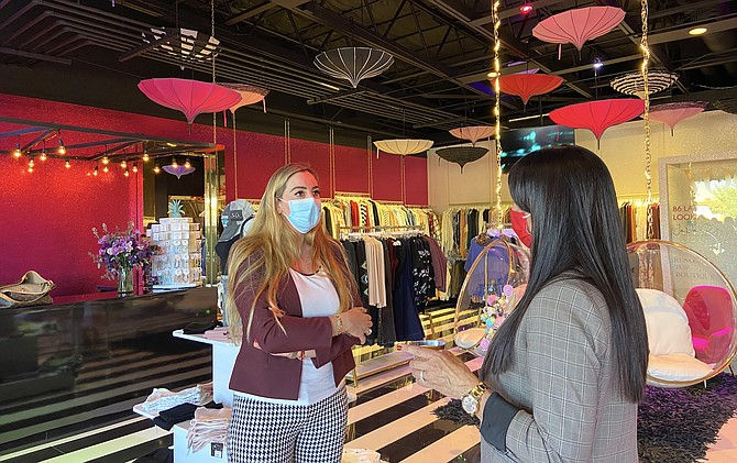 JaDa Loft Boutique co-owner Monica Rios, left, speaks with a shopper on Tuesday, Sept. 28, 2021, at the retailer's new South Reno location.