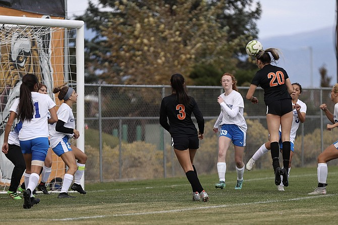 Aleeah Weaver (20) puts her head to a goal in the second minute of Douglas' 2-1 win over Carson Wednesday.