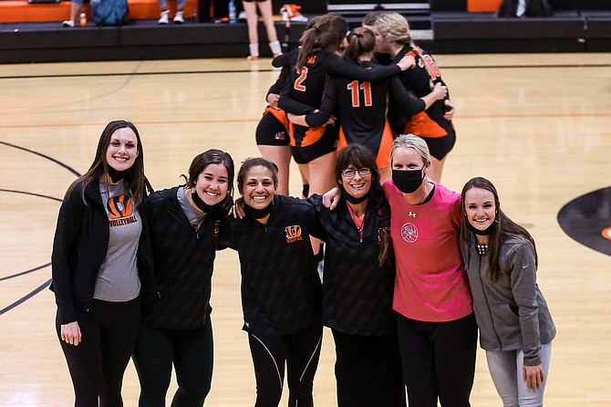 A group of Douglas High coaches pose for a photo prior to the Tigers game against Carson. Pictured from left to right are assistant coaches Keely Latham, Brenna White, Mysta Townsell, head coach Suzi Townsell, Jill Couwenhoven and Montrashay Worley.
