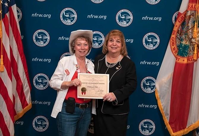 FRW President Anita Trone, left, accepts the Diamond Achievement award from NFRW President Ann Schockett.