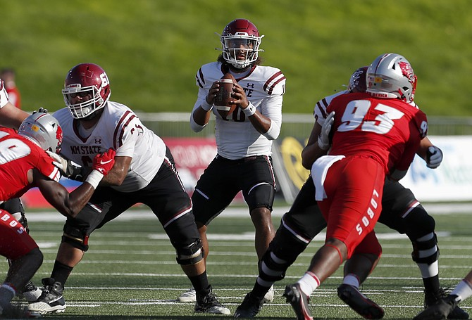 New Mexico State quarterback Jonah Johnson looks to pass against New Mexico on Sept. 11, 2021, in Albuquerque, N.M. (AP Photo/Andres Leighton)