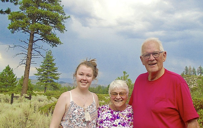 Morgana-le-Fae, Edie, and Skip Veatch with the view they have enjoyed for the last 43 years, rebuilding in the same spot after their home burned in the Acorn Fire.