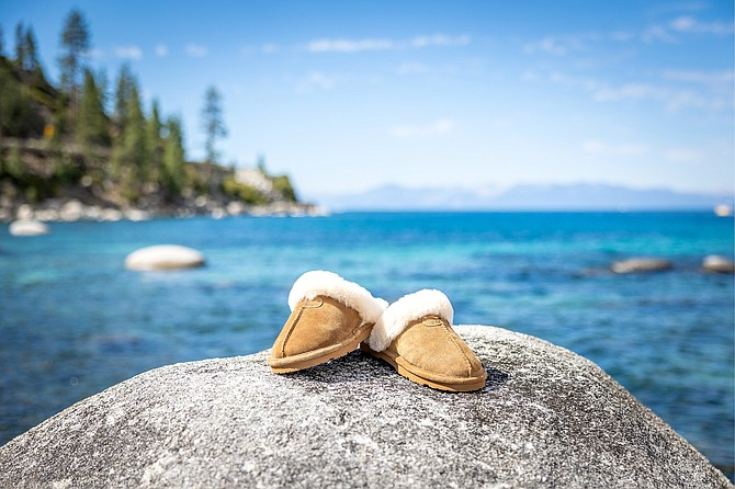 BEARPAW utilizes sheepskin and other natural and sustainable products to create comfort-focused footwear, like the slippers seen here.