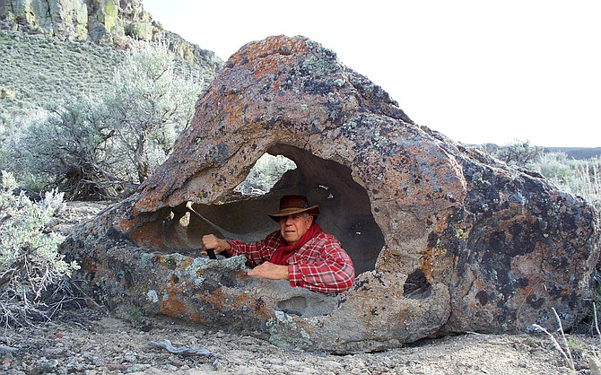 """Courtesy Dennis Cassinelli in the driver's seat of """"prehistoric SUV."""""""