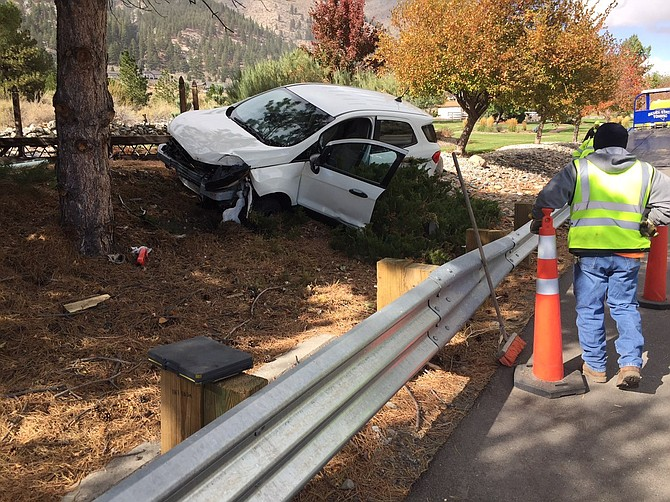 A tree along Jacks Valley Road stopped this vehicle from ending up in Sierra Creek on Monday afternoon in this photo submitted by a Genoa resident. The occupant was taken for medical treatment by East Fork medics.