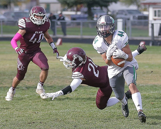Fallon's Isiah Diaz catches a ball behind Elko's Jacob Aguirre (on ground), Christian Felix (40) and Cael Sellers (right) for a 26-yard touchdown.