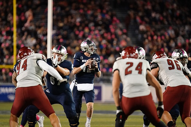 Nevada's Carson Strong looks to pass against NMSU.
