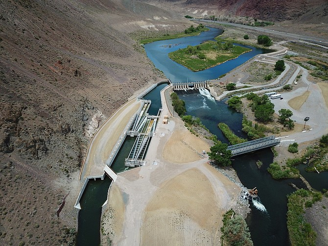 A view looking north shows a flowing Truckee River, the Derby Dam and newly completed fish screens in this 2020 photo.