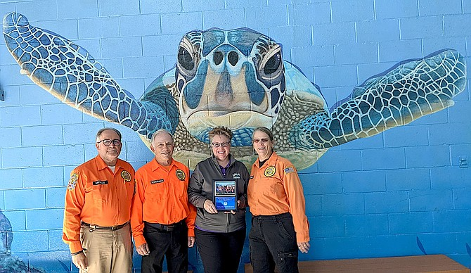 East Fork Swimming Pool District CEO Shannon Harris receives a plaque thanking Carson Valley Swim Center on Tuesday.