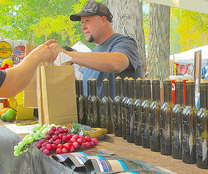 A crafter sells balsamic vinegar at the mother of all Carson Valley craft fairs, Candy Dance.