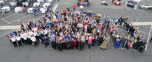Community members gather for a photo to celebrate the Nevada Appeal's 150th anniversary on Saturday.