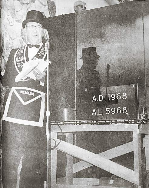 Harry M. Overbey, deputy grand master of the Grand Lodge F&AM of Nevada, addresses persons attending cornerstone ceremonies dedicating the new Legislative Building. The ceremonies were conducted by the Masons, the same organization which held the ceremony for the State Capitol Building 100 years ago.