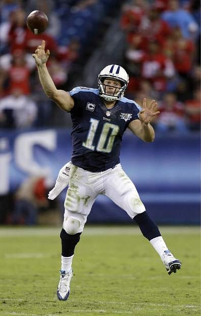 Tennessee Titans quarterback Jake Locker passes against the San Francisco 49ers in the fourth quarter of an NFL football game on Sunday, Oct. 20, 2013, in Nashville, Tenn. The 49ers won 31-17. (AP Photo/Wade Payne)