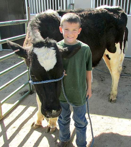 Parker Story of Dayton representing the Arrowhead Livestock Club with Amelia. The work 4-H kids will be display at the NV150Fair beginning July 31.