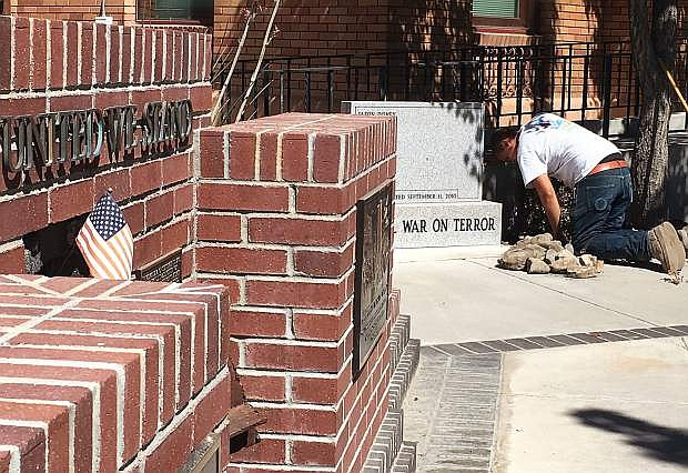 A city worker from the Parks Department spruces up the memorials for Sunday's 9/11 ceremony.