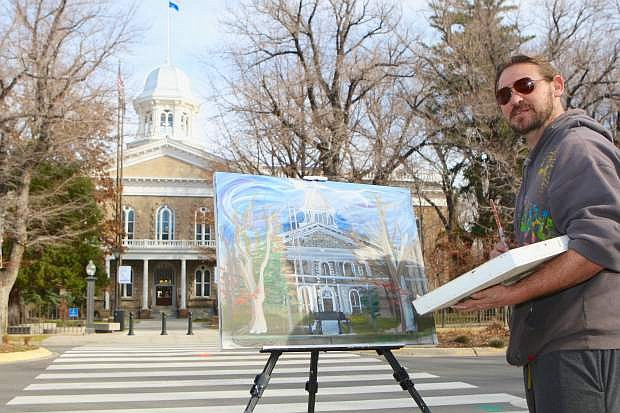 Jonathan Triplett paints a rendition of the Capitol building in Carson City Thursday. Triplett stated that proceeds from the sale of his painting will be donated to WNC's 'Always Lost'. Always Lost: A Meditation on War includes the 2004 Pulitzer Prize-winning Iraq War combat photographs by David Leeson and Cheryl Diaz Meyer (courtesy of The Dallas Morning News) with literary work by Professor Marilee Swirczek's creative writing classes, veterans and their families, the Lone Mountain Writers group, and other Northern Nevada writers. It is funded and maintained in part by grants and donations. To make a financial contribution, contact the Western Nevada College Foundation at 775.445.3240 or www.wnc.edu/foundation.