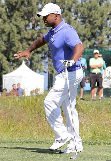Alfonso Ribeiro busts a move prior to teeing off at the first hole on Friday.