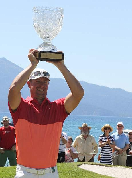 Former MLB pitcher Mark Mulder hoists the trophy after winning the 2016 American Century Championship on Sunday at Edgewood Tahoe Golf Course.