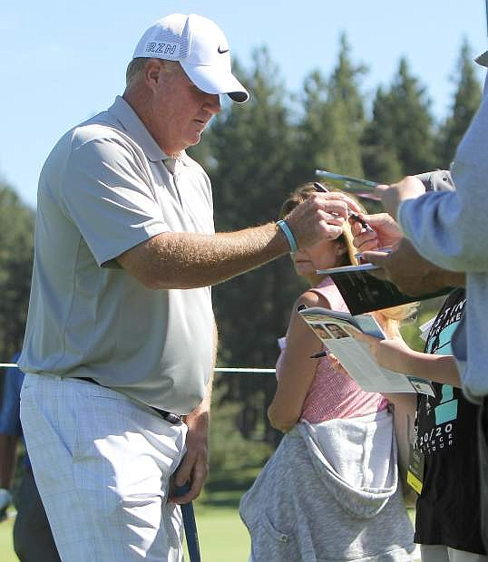 Tournament favorite Billy Joe Tolliver signs autographs for fans during the Lake Tahoe Celebrity-Am Tournament Tuesday. The four-time ACC champion entered the tournament with 7-2 odds.