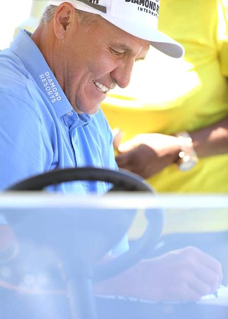 Mark Rypien a 2-time winner of the American Century Championship signs an autograph at Edgewood on Tuesday.