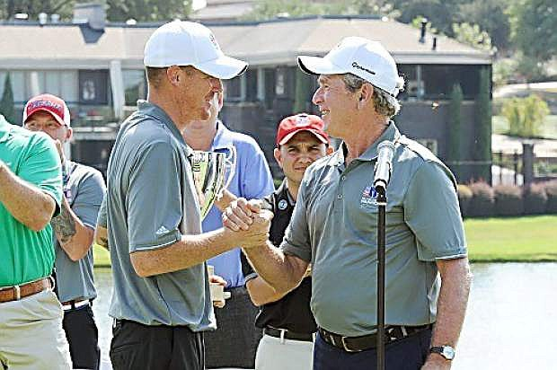 Former President George W. Bush congratulates 2015 Warrior Open champion Andrew Bachelder. Bachelder, a retired Marine Staff Sgt. who was seriously injured in a helicopter collision in Iraq, will join the star-studded celebrity field in Lake Tahoe at the 2016 American Century Championship in July.
