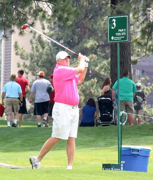 Former National Football League quarterback Billy Joe Tolliver tees off during Wednesday's Lake Tahoe Celebrity-Am Tournament at Edgewood Tahoe Golf Course.