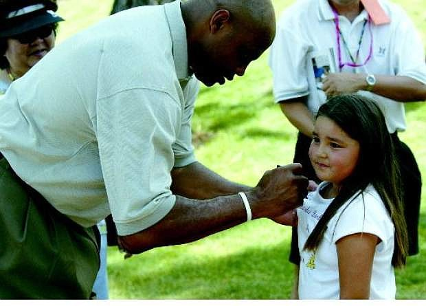 Charles Barkley signs an autograph at a previous American Century Championship. South Lake Tahoe native Preston Garrison will never forget his afternoon spent with  Barkley some 20 years ago.