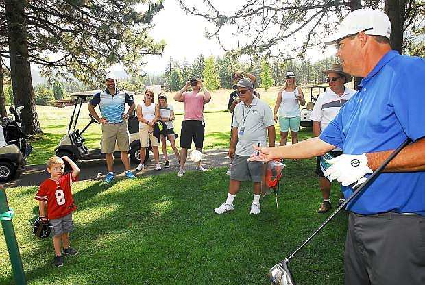 Greg Maddux tosses a signed baseball to a young fan during a practice round earlier this week at the American Century Championship at Edgewood-Tahoe Golf Course in Stateline. Maddux will be inducted into the baseball hall of fame later this month.