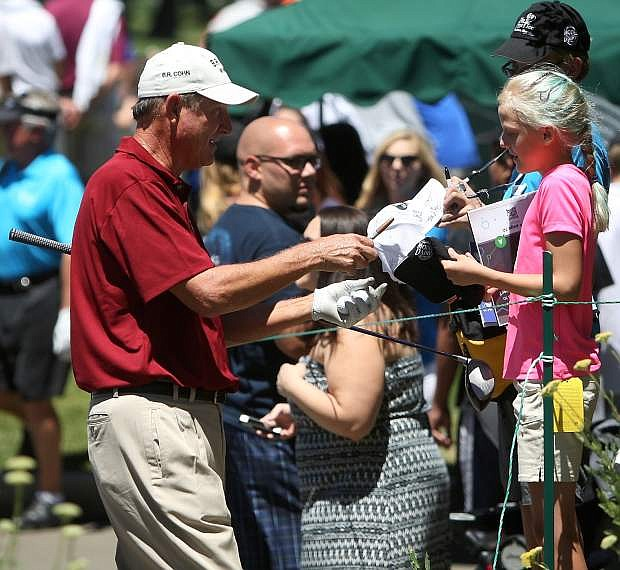 Eight-time champion and former MLB pitcher Rick Rhoden makes a young fan's day before teeing off for a practice round Wednesday at Edgewood Tahoe Golf Course.