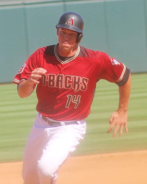 Peter O'Brien rounds the base against Seattle in a March 14 spring training game in Scottsdale, Ariz.