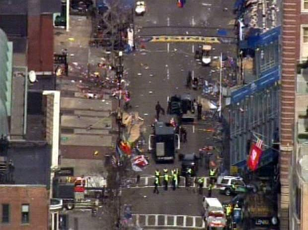 Medical workers and authorities work on the scene near the finish line of the 2013 Boston Marathon following an explosion in Boston, Monday, April 15, 2013. (AP Photo/WCVB-TV/ABC)