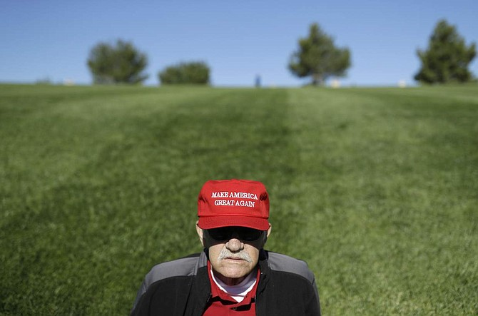 Jack Bussard of Las Vegas waits for the start of a rally with Republican presidential candidate Donald Trump, Wednesday, Oct. 5, 2016, in Las Vegas. (AP Photo/John Locher)