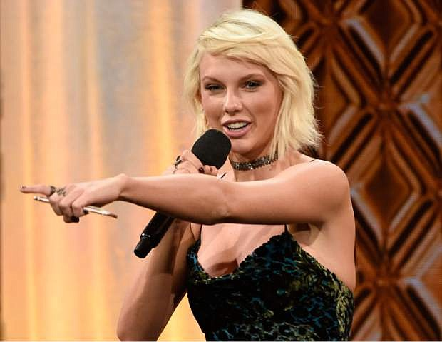 FILE - In this May 10, 2016 file photo, Taylor Swift accepts the BMI Taylor Swift Award at the 64th annual BMI Pop Awards at the Beverly Wilshire Hotel in Beverly Hills, Calif. The singer-songwriter tops Forbes' annual list of the 100 highest-paid celebrities with $170 million.  (Photo by Chris Pizzello/Invision/AP, File)