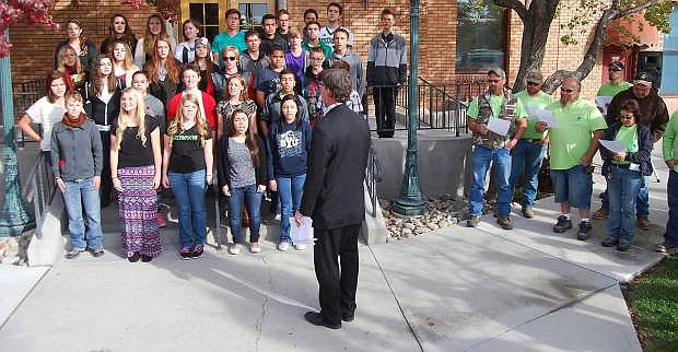 """Several hundred people assembledbehind City Hall Thursday morning to take part in a statewide singing of the state's song, """"Home Means Nevadas."""" Churchill County High School choir director Tom Fleming leads the Minor Details."""