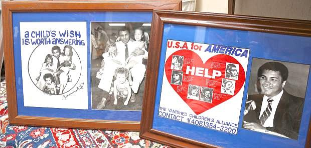 Two of Ali's charities dedicated to children are pictured here Wednesday at Charles Adams' home in Carson City.