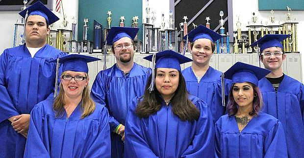 Students from the Adult Education Diploma Program get ready to walk to the stage and to receive their diploma. Back left are Ryan Wiersma,  Michael Wegner,  Alan Soles and David Jackson. Front from left are LaDonna Gaines, Melissa Miles and Bianca Castillo.