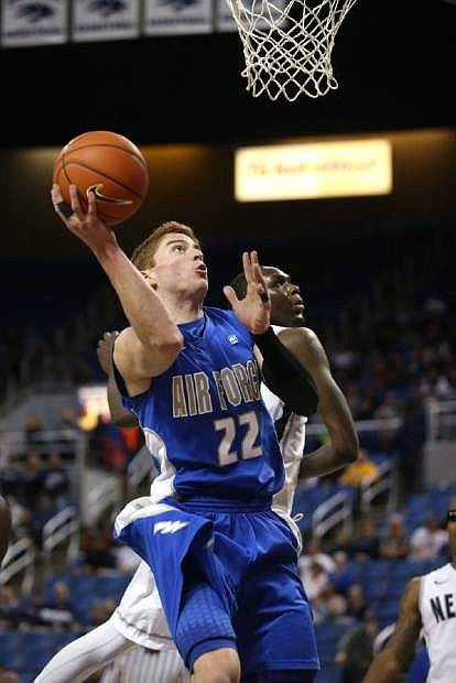 Air Force's Max Yon (22) shoots past Nevada defender Jerry Evans Jr. during an NCAA college basketball game in Reno, Nev., Saturday, Feb. 1, 2014. Nevada won 69-56 in overtime. (AP Photo/Cathleen Allison)